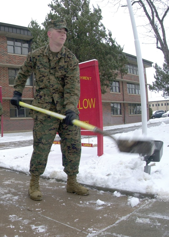 Marine Pfc. Donald Wolcott, a tech school student, shovels snow from the sidewalk leading to the Marine Corps Detachment Wednesday.  Goodfellow experienced its first snow fall of the year Tuesday.  Base personnel were released early from duty Tuesday afternoon and were ordered to report to work by no later than 9:30 a.m. Wednesday.  Personnel were once again released from duty by 2 p.m. Wednesday.  The early releases were done as a preventative measure by the senior leadership because of the hazardous driving conditions caused by the snow storm and cold weather conditions of the week.  Several areas of Goodfellow received two to three inches of snow. (U.S. Air Force photo by Airman 1st Class Luis Loza Gutierrez)
