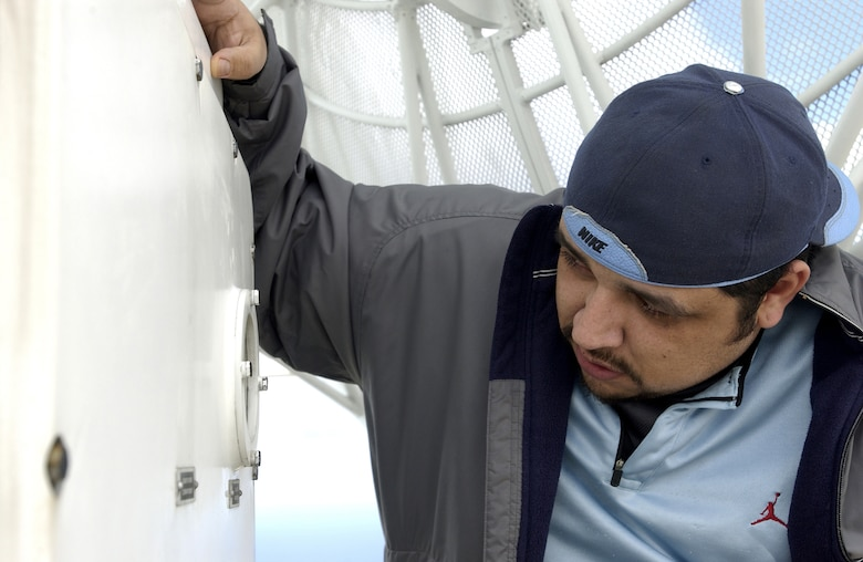 Salvador Sanchez, contractor for Western Range Operations Communications and Information (WROCI), checks the oil of the FPS-16 radar.  The radar is used to track Vandenberg launches from atop Tranquillon Peak on Vandenberg AFB.  The oil inside the radar is used for mobility purposes so it is able to move 360 degrees without getting stuck, thus able to track the upcoming Minuteman III missile launch on Feb. 7.  (U.S. Air Force photo by Airman 1st Class Ashley Tyler)