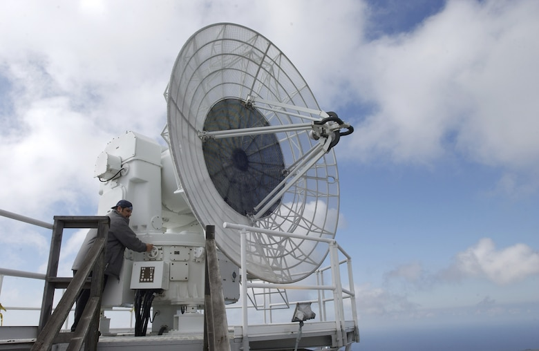 Salvador Sanchez, contractor for Western Range Operations Communications and Information (WROCI), rotates the FPS-16 radar used to track launching missiles at Tranquillon Peak on Vandenberg AFB February 1, 2007. The radar is used to provide data and track missiles during launches. This radar, along with its data system, will be tracking the upcoming Feb. 7 Minuteman III launch to direct the missile and ensure its direction is not altered.  (U.S. Air Force photo by Airman 1st Class Ashley Tyler)