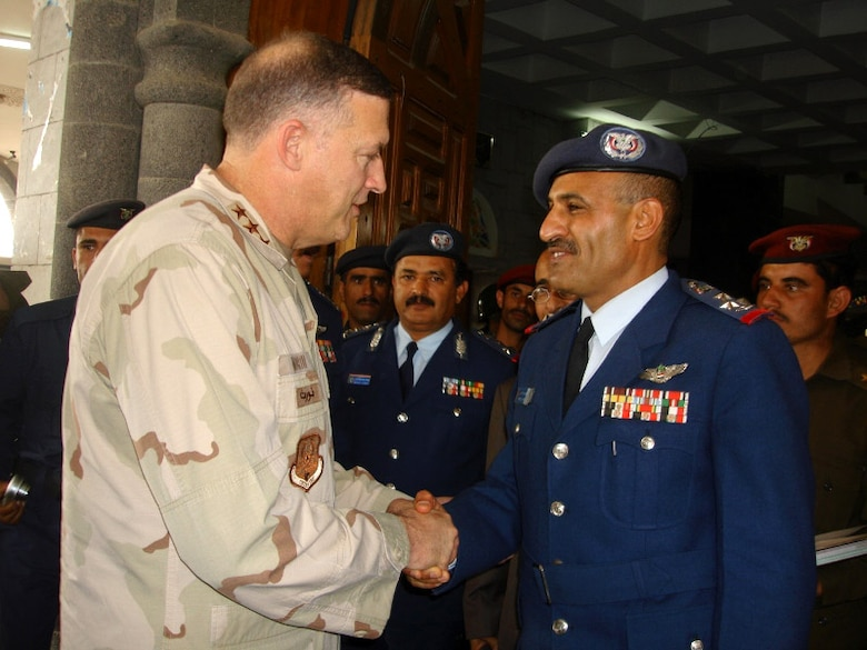 Lt. Gen. Gary L. North says goodbye to Yemeni Brig. Gen. Mohammed Saleh Al-Ahmar as he leaves the Yemeni air force headquarters Feb. 7 in Yemen. General North is the commander of U.S. Central Command Air Forces and met with senior Yemini air force officials and the U.S. ambassador to Yemen. (U.S. State Department photo/Ann Marie Roubachewsky)