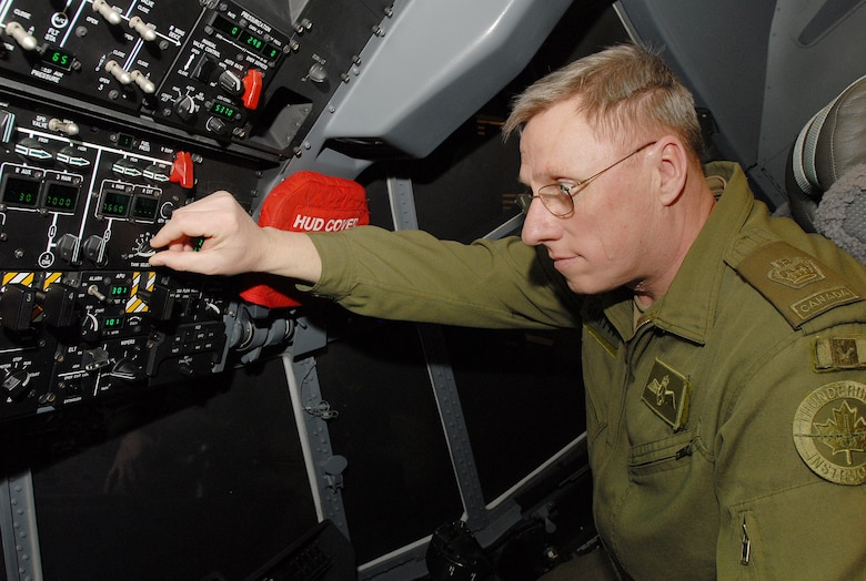 Canadian Warrant Officer Blair Smith examines a C-130J flight instruments on a maintenance training tool at Little Rock Air Force Base, Ark.,  Jan. 30, 2007.  Canadian air force representatives recently visited the base to view C-130J operations and training procedures in preparation for the purchase of C-130J's in the near future. (U.S. Air Force photo by Airman 1st Class Nathan Allen)