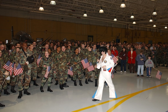 """""""Elvis,"""" Lt. Col. Jeffery Snell, 14th Operations Group, entertains almost 1,000 BLAZE Team Airmen and civilians waiting for the arrival of the Commander-In-Chief Installation Excellence Selection Board members."""