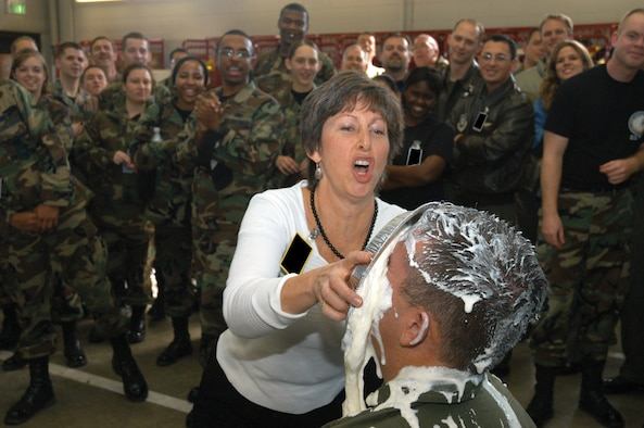 SCHRIEVER AIR FORCE BASE, Colo. -- Laura Hyten splatters her husband, Col. John Hyten, with whipped cream pie during a pie-in-the-face event at the fire station here Feb. 8. Donations toward the event raised more than $1,500 for the 50th Space Wing annual awards, the Schriever Airmen's Council and Operation Warm Heart. Colonel Hyten is the 50th SW commander. (U.S. Air Force photo/Staff Sgt. Don Branum)