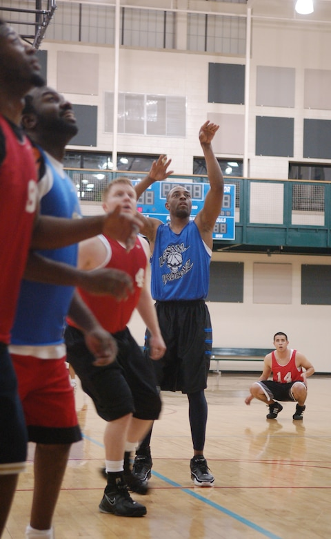 LAUGHLIN AIR FORCE BASE, Texas -- Members of the Laughlin Consolidated Services Aircraft Maintenance and 47th Operations Support Squadron intramural basketball teams anxiously watch and prepare to rebound a penalty free-throw shot put up by the LCSAM team's Ryan Dobbins Feb. 7.  The OSS team beat LCSAM 40-30.  (U.S. Air Force photo by Staff Sgt. Austin M. May)
