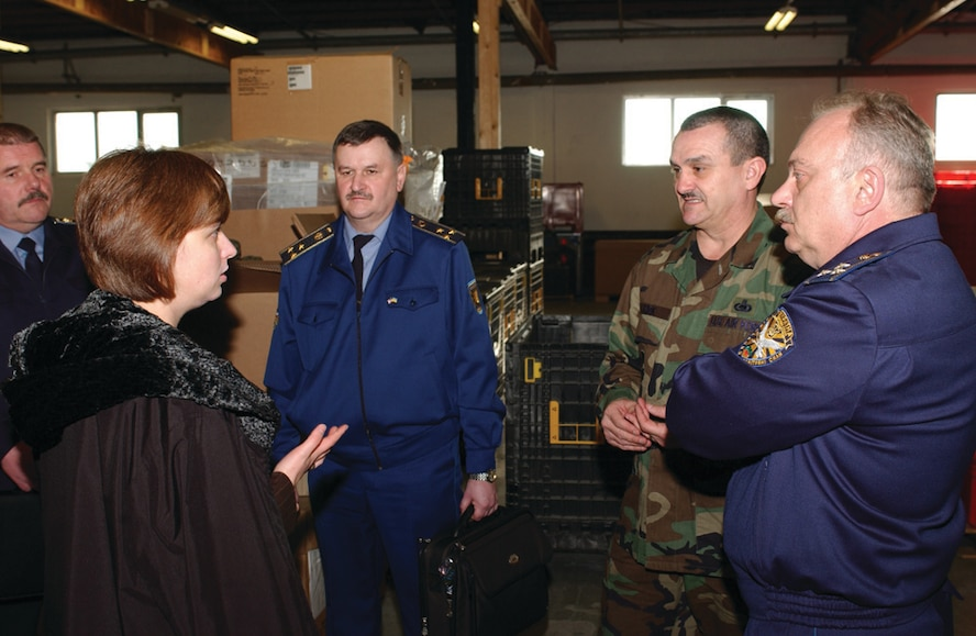 Chief Master Sgt. Dusty Kirk, 52nd Logistics Readiness Squadron, explains supply operations as, Iryna Yantalets, Ukrainian interpreter, translates for visiting Ukrainian armed forces officers. (US Air Force photo by Airman 1st Class Stephanie Sawyer)