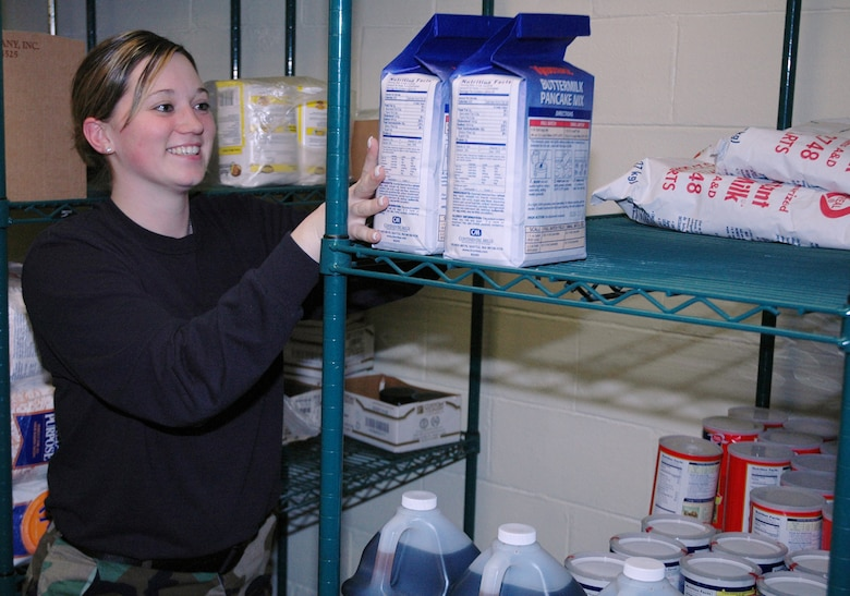 OSAN AIR BASE, Republic of Korea --  Senior Airman Heather Kendrick, 51st Services Squadron, shelves pancake mix in the Pacific House Dining Facility storeroom Feb. 6. As the storeroom manager, Senior Airman Kendrick is in charge of all of the food inventory for the dining facility. (U.S. Air Force photo by Staff Sgt. Benjamin Rojek)