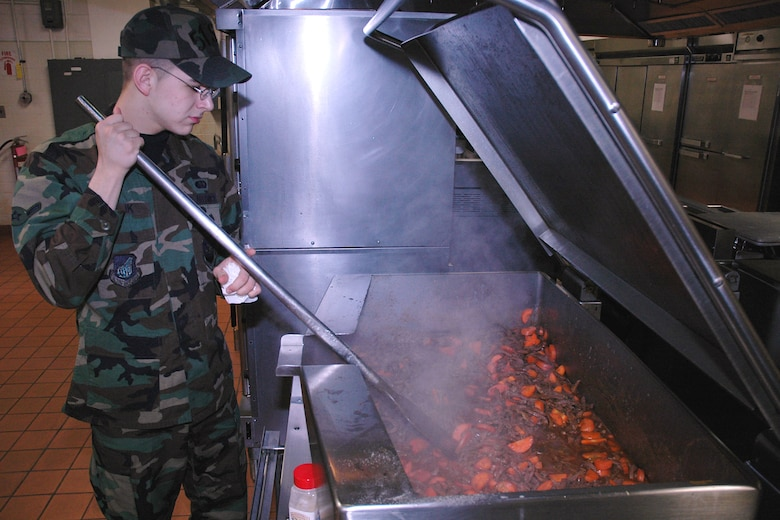 OSAN AIR BASE, Republic of Korea --  Airman Jason Relik, 51st Services Squadron, prepares paprika beef for dinner Tuesday. Airman Relik is a food service apprentice at the Pacific House Dining Facility here. (U.S. Air Force photo by Staff Sgt. Benjamin Rojek)