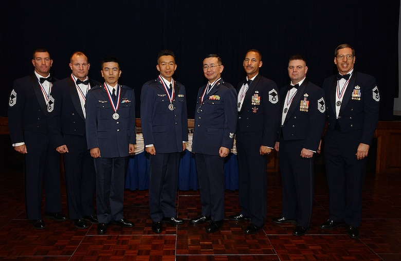 YOKOTA AIR BASE, Japan -- The following chiefs and chief selects were inducted at a ceremony Feb. 2. Left to right: Chief Master Sergeants Scott Cornell, 374th Civil Engineer Squadron; Howard Heisey, 374th Logistics Readiness Squadron, Akihiko Ishibashi, Japan Air Self Defense Force Signal Intercept Squadron, Hiroshi Kurakata, Ichigaya Air Station, Air Staff Office training section; Osamu Otaki, HQ Air Intelligence Wing, Fuchu Air Base; and Senior Master Sergeants Michael Breazell, PACAF Air Postal Squadron; Charles Funkhouser, 374 CES and Eric Strohecker, USAF Band of the Pacific-Asia. (U.S. Air Force photo by Airman 1st Class John Albea)