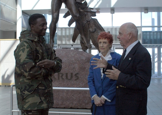 DAYTON, Ohio - Robert Brandt (right), a volunteer in the 8th Air Force Control Tower and Nissen Hut at the National Museum of the U.S. Air Force, and his wife Bette greet 88th Air Base Wing Vice Commander Col. Neal B. McElhannon (left). Brandt received the Team Wright-Patt Volunteer of the Quarter award for Fourth Quarter 2006.
