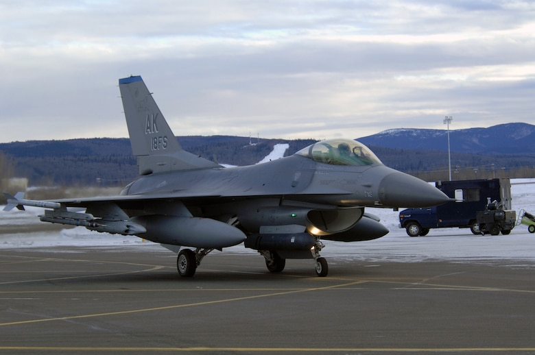 EIELSON AIR FORCE BASE, Alaska -- An F-16C Fighting Falcon aircraft from the 18th Fighter Squadron taxis on the flightline here prior to taking off for a training mission on Feb.8. The 18th Fighter Squadron conducts air operations for combat-ready F-16 aircraft and provides close air support, forward air control (airborne), battlefield air interdiction, and offensive counter air.