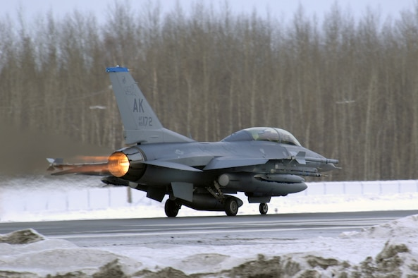 EIELSON AIR FORCE BASE, Alaska -- An F-16D Fighting Falcon aircraft from the 18th Fighter Squadron takes off from the flightline here for a training mission on Feb.8. The 18th Fighter Squadron conducts air operations for combat-ready F-16 aircraft and provides close air support, forward air control (airborne), battlefield air interdiction, and offensive counter air. (U.S. Air Force Photo by Staff Sgt Joshua Strang)