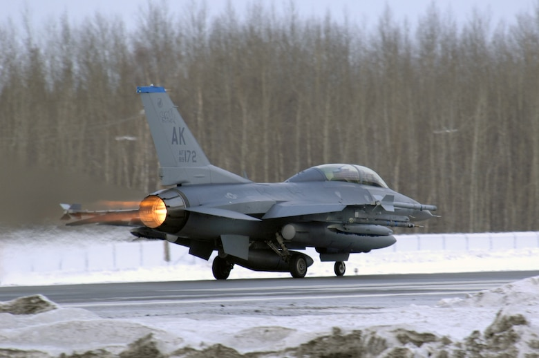 EIELSON AIR FORCE BASE, Alaska -- An F-16D Fighting Falcon aircraft from the 18th Fighter Squadron takes off from the flightline here for a training mission on Feb.8. The 18th Fighter Squadron conducts air operations for combat-ready F-16 aircraft and provides close air support, forward air control (airborne), battlefield air interdiction, and offensive counter air.