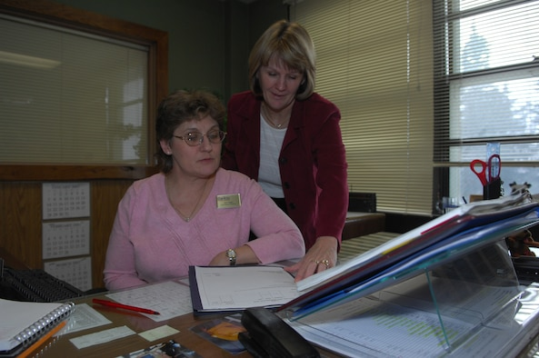 MINOT AIR FORCE BASE, N.D. – Mary Brown (left) and Joni Hogan, both from the 5th Services Squadron, look over paperwork here. Mrs. Brown was recently selected as recently selected 2006 Air Combat Command Services Individual Senior Civilian Manager of the Year.
