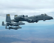 Three A-10 Thunderbolt IIs fly in formation. A-10s provided close-air support for a scout team that received small arms fire Feb. 11 near Balad, Iraq. The A-10s observed the team apprehend the individuals responsible for the small arms fire and provided reconnaissance until the team returned to their forward-operating base. (U.S. Air Force photo/Senior Airman Christina D. Ponte)