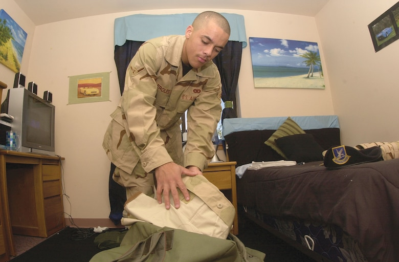 Airman Michael Eroles, a member of the 17th Security Forces Squadron, packs his duffle bag Wednesday inside his bedroom here. Airman Eroles is one of several servicemembers from Goodfellow scheduled to deploy this month.  	