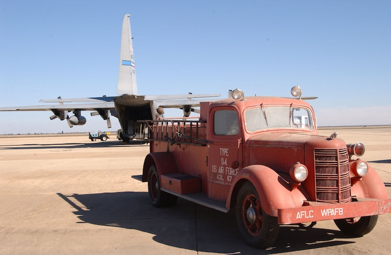 A 1942 Mack Model 125 fire truck on the flightline at Mathis Field San Angelo Regional Airport. The fire truck, to be used as a static display at the outdoor museum on Goodfellow, was transported by a C-130 Hercules from the 910th Airlift Wing, Youngstown, Ohio.  (U.S. Air Force photo by Staff Sgt. Angela Malek.)