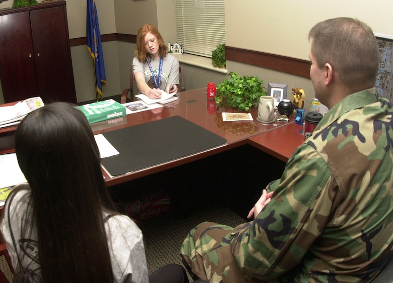 Grace Foulk, Goodfellow Monitor guest reporter (at center), interviews Maj. Stephen Cristofori, 17th Comptroller Squadron commander, about being a volunteer mentor during this year's Groundhog Job Shadow Day, while Mayra Del Riva, a freshman from Lakeview High School and participant in the program, listens in. (U.S. Air Force photo by Airman 1st Class Luis Loza Gutierrez)