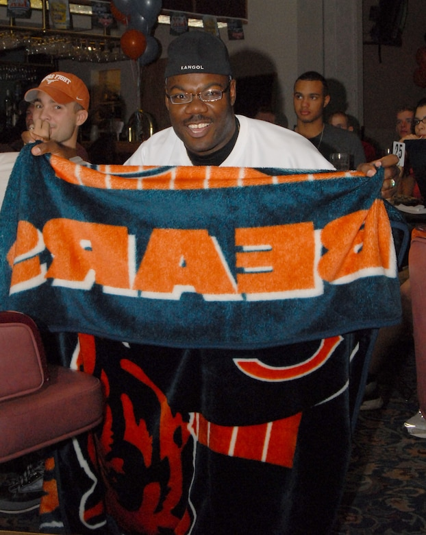 Master Sgt. Reginald Booker, a member of the 82nd Training Wing, Sheppard Air Force Base, Texas, displays his loyalty to the Chicago Bears during the Super Bowl party. (U.S. Air Force photo by Airman 1st Class Luis Loza Gutierrez.)