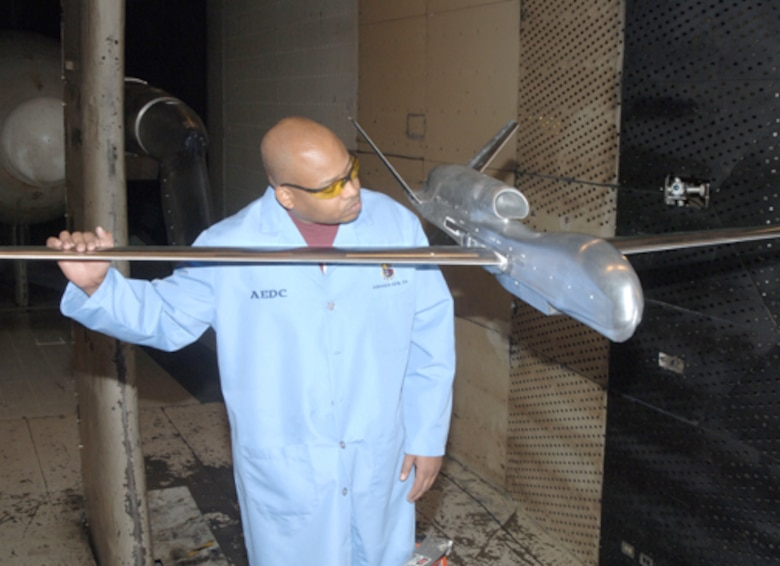 Jeffrey Castleman, ATA outside machinist, inspects the Global Hawk model being used for aerodynamic testing in AEDC's 16-foot transonic wind tunnel.