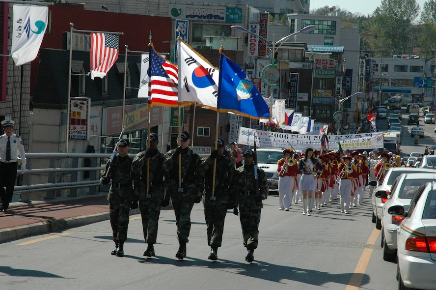 SONGTAN, Republic of Korea -- Airmen from the Osan Air Base Honor Guard march in the annual Korean/American Friendship Festival Parade here in September. (U.S. Air Force photo by Tech. Sgt. Micahel O'Connor)