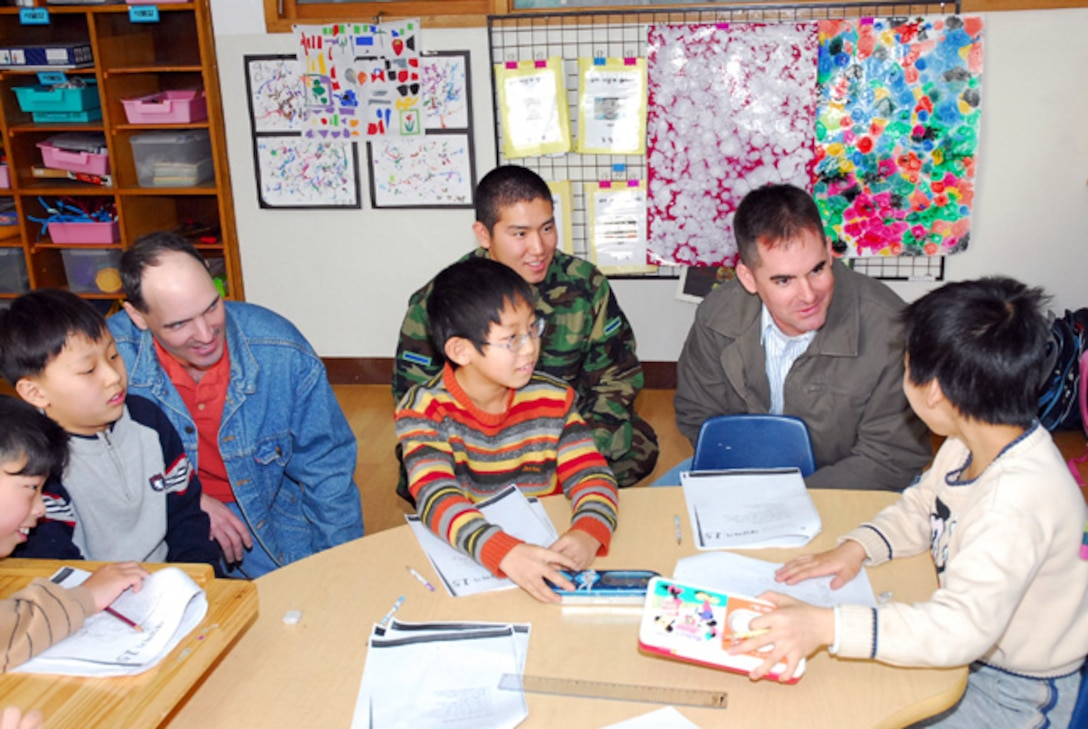 PYONGTAEK, Republic of Korea --  Republic of Korea and U.S. Air Force Airmen visit a learning center for children and young adults with disabilities. (Courtesy photo)
