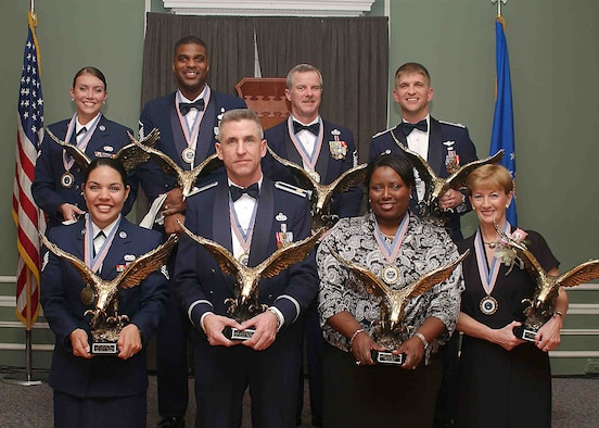 SHAW AIR FORCE BASE, S.C. -- The 20th Fighter Wing presents its annual award winners Feb. 9 at a ceremony in Carolina Skies. First row, from left: Staff Sgt. Othelia Carlson, 20th Communications Squadron, 20th FW NCO of the Year; Maj. Edward Earhart, 20th Equipment Maintenance Squadron, 20th FW Field Grade Officer of the Year; Sharla Pope, 20th Comptroller Squadron, 20th FW Civilian Employee of the Year for GS-6 or WG-7 employees and below, and Anne Baker, 20th Contracting Squadron, 20th FW Civilian Employee of the Year for GS-7 or WG- 8 employees and above. Second row, from left: Airman 1st Class Crystal Moore, 20th Security Forces Squadron, 20th FW Airman of the Year; Master Sgt. James Powell III, 20th Aeromedical-Dental Squadron, 20th FW Senior NCO of the Year; Master Sgt. John Walker, 20th SFS, 20th FW First Sergeant of the Year, and Lt. Col. Stephen Higgins, 20th Medical Group deputy commander, accepting the 20th FW Company Grade Officer of the Year award on behlaf of Capt. Kourtney Shaw, 20th AMDS. (U.S. Air Force photo/Staff Sgt. Nathan Brevier)