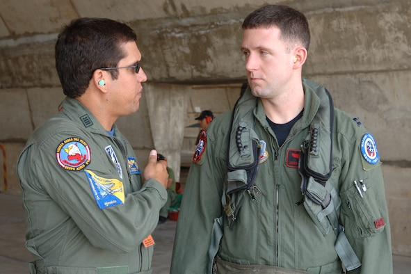 Capt. Jordan Carvell (right) discusses pre-flight instructions with Peruvian Lt. Col. Antonio Cossion during Exercise Falcon Condor 07 before flying in a Peruvian Mirage 2000. The exercise allows the U.S military to build relationships with military and civilian leaders of Peru. Captain Carvell is a pilot assigned to the 34th Fighter Wing at Hill Air Force Base, Utah. (U.S. Air Force photo/Staff Sgt. Lee Hoover)