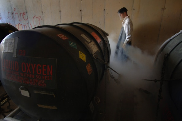 BALAD AIR BASE, Iraq--Staff Sgt. Gabriel Temples of the 332nd Expeditionary Logistics Readiness Squadron vents the Liquid Oxygen (LOX) tanks to prevent pressure build up in the storage containers; liquid oxygen is used in aircraft that fly at high altitudes where there isn't enough oxygen for the Aircrew. Staff Sgt. Temples is deployed from 5th Logistic Readiness Squadron, Minot Air Force Base, N.D. The 332nd Expeditionary Logistics Readiness Squadron POL Flight is responsible for all fixed wing aircraft and most rotary aircraft on Balad Air Base.  (U. S. Air Force photo by Staff Sgt. Michael R. Holzworth) (Released)