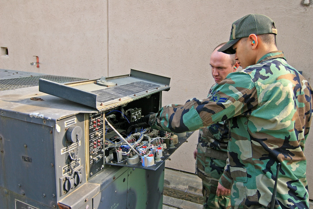 OSAN AIR BASE, Republic of Korea -- Tech. Sgt. Dennis Odom and Airman 1st Class Justin Tayamen, 51st Civil Engineer Squadron power production element, diagnose a generator. The 16-member power production element of the 51st Civil Engineer Squadron maintains and repairs more than 150 generators on Osan, as well as Aircraft Arresting Systems and Mobile Aircraft Arresting Systems. (U.S. Air Force photo by Master Sgt. Ben Huseman)