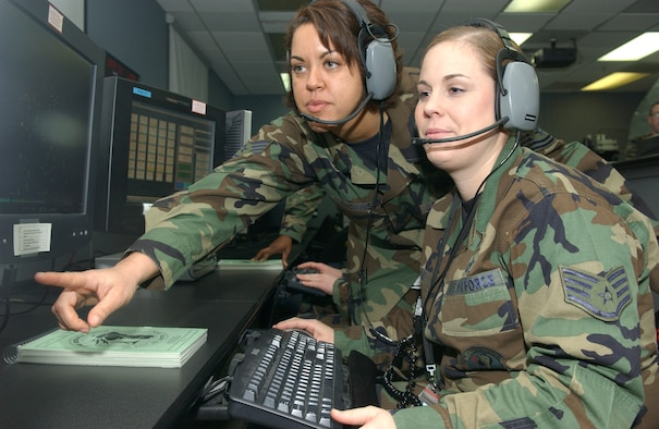 OSAN AIR BASE, Republic of Korea --  Tech. Sgt. Julia Dickinson (left) and Staff Sgt. Andrea Perales, 621stACS use Battle Control System - Korea to monitor several aircraft flying on the peninsula Monday. (U.S. Air Force photo by Senior Airman Eunique Stevens)
