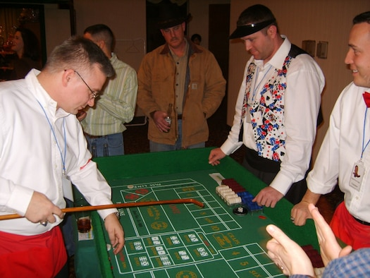OSAN AIR BASE, Republic of Korea --  Patrons of the Osan Officers' Spouses' Club's Wild West Night enjoy a game of craps Feb. 3. (Photo by Maj. Frank Schreiber)