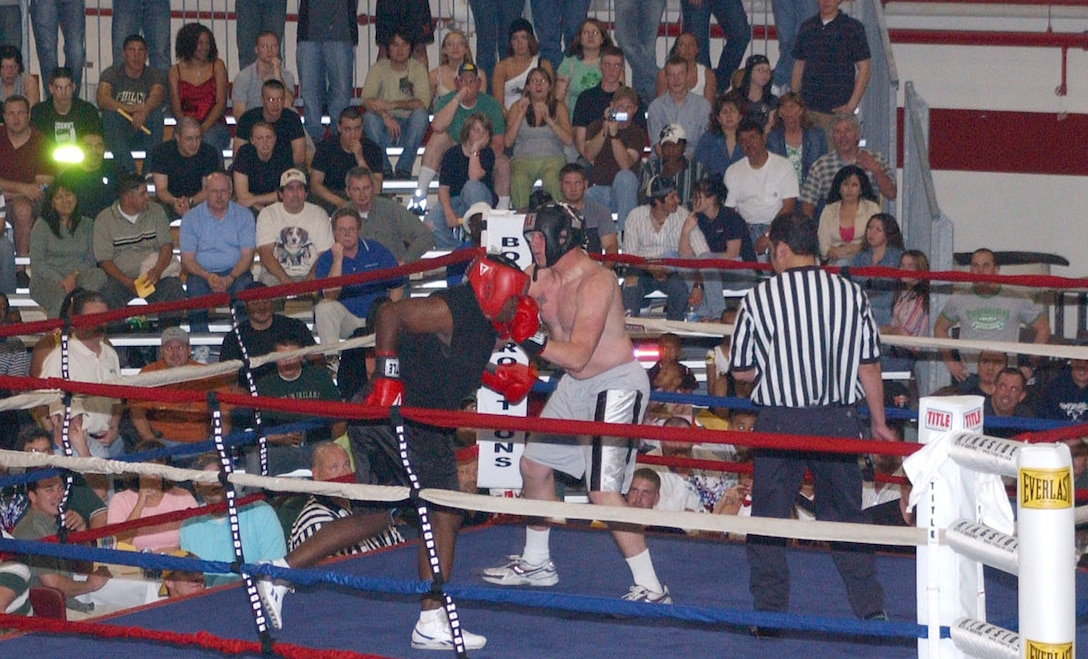 This scene from last year is repeated at 7 p.m. Friday in Hangar 4.  Eight fights are scheduled in each of three weight classes.  General admission, $15; reserved table for 10, $20 per person; reserved ringside table for 10, $25 per person.  Cash prize of $1,000 in each division.  This event is open to the public.  For more information, call 669-8700 or 377-7858.   (U.S. Air Force photo by Kemberly Groue)