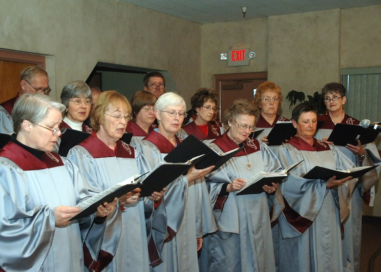 The Chancel Choir leads the audience in song during the National Prayer Breakfast Tuesday at the Base Chapel.