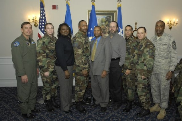 From left to right:  Gen Smolen, Capt Tara Parker, CGO of the Qtr; Ms Gloria Longmire, Civ of the Qtr, Category I; TSgt Antonio Lindsay, NCO of the Qtr; Mr Phillip Henry, Civ of the Qtr, Cat II; Mr Neal West, Civ of the Qtr, Cat III; SrA Gabriel Urdaneta, Airman of the Qtr; SMSgt Thomas Cooper, SNCO of the Qtr; Chief Monroe