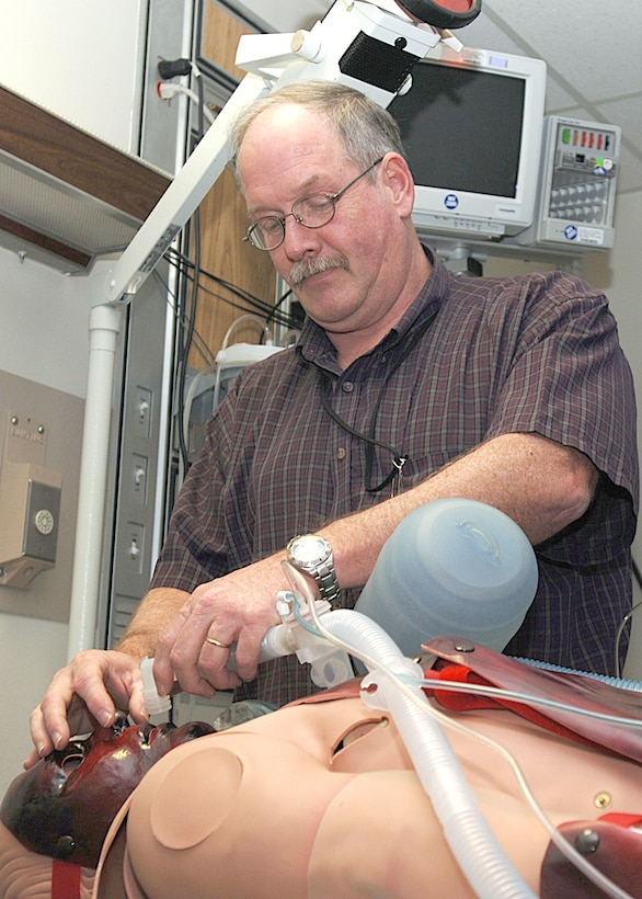John Mechtel sets up a replicated burn victim's airway in one of the simulation center's scenario rooms at Wilford Hall Medical Center Feb. 9 at Lackland Air Force Base, Texas. The center has trained more than 1,400 people since July 2005 and has the capability to train complex medical concepts using virtual reality simulators, task trainers and high-fidelity mannequins that respond correctly to procedures and therapies rendered by medics. Mr. Mechtel is the 59th Medical Wing Simulation Center program manager. (U.S. Air Force photo/Staff Sgt. Ruth Stanley)