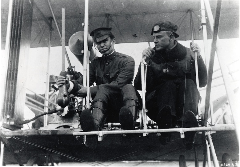 Phil Parmalee and Lt. Myron Crissy (left) with first live bomb in a Wright plane, Los Angeles, Jan. 15, 1911. (U.S. Air Force photo)