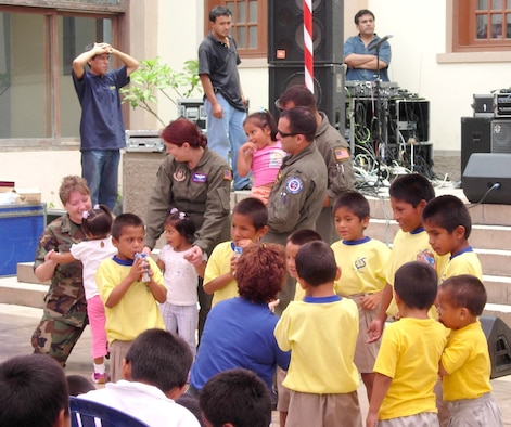 Aircrew members visit with children at a local foster home Feb. 16 at Lima, Peru. Airmen in Peru wrapped up the joint exercise Falcon and Condor 2007 this week and are remaining there for the first joint air show with the Peruvian Air Force this weekend. The Peruvian air show will be the first of the year for aircraft from the 12th Air Force and Air Forces Southern. The joint exercise and air show directly supports U.S. Southern Command's engagement goals and furthers relations between allied nations. (Courtesy photo)