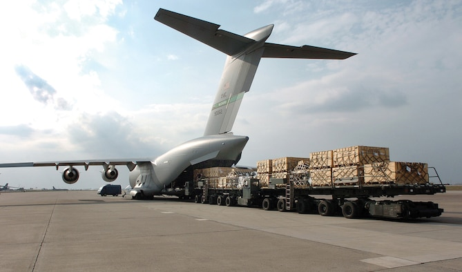 MCCHORD AIR FORCE BASE, Wash., --Pallets of cargo are off-loaded from a C-17 Globemaster III in support of OIF. Airmen from the 817th EAS have transported cargo on more than 1, 211 combat sorties. (U.S. Air Force photo)