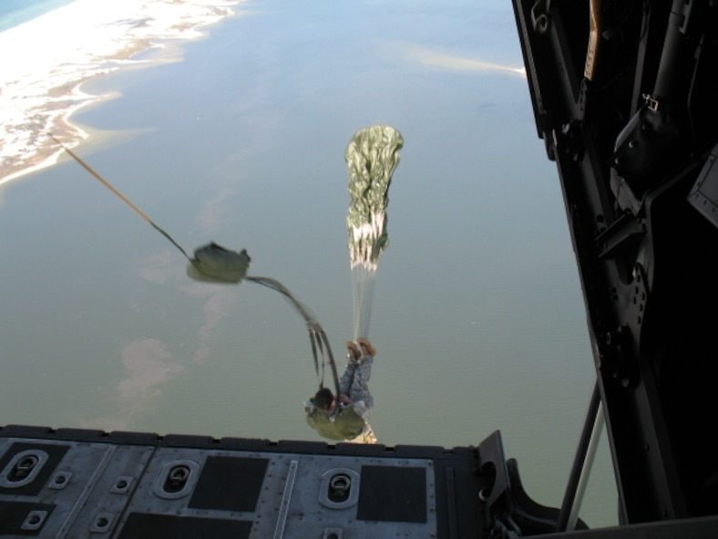 A Joint Ground Liaison student performs a static line jump from an MC-130 into the Gulf of Mexico. (Photo by Chief Warrant Officer Todd Sowerby.)