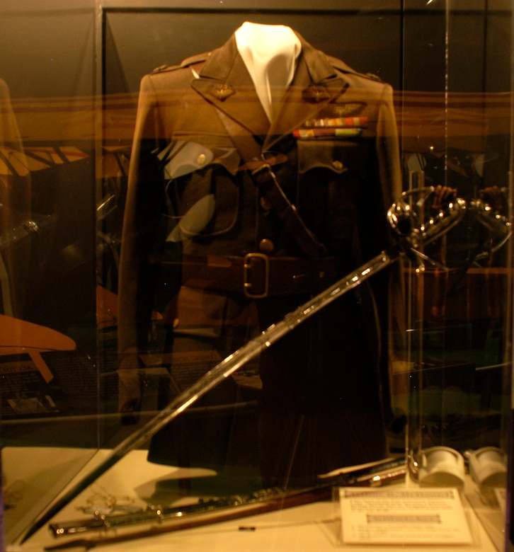 DAYTON, Ohio -- Capt. Arthur B. McDaniel's identification tags, service coat from the early 1930s when he was a major, dress sword and swagger stick on display in the Early Years Gallery at the National Museum of the U.S. Air Force. Like most of the Pan American Flyers, McDaniel later became a general during World War II. He passed away in December 1943 at the age of 43. (U.S. Air Force photo)