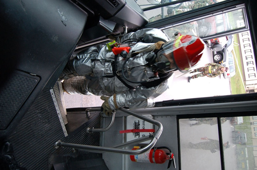 SPANGDAHLEM AIR BASE, GERMANY -- A 52nd Civil Engineer Squadron firefighter climbs the steps of a bus that was part of a simulated multi-vehicle accident Feb. 9.   (US Air Force photo by Senior Airman Eydie Sakura)