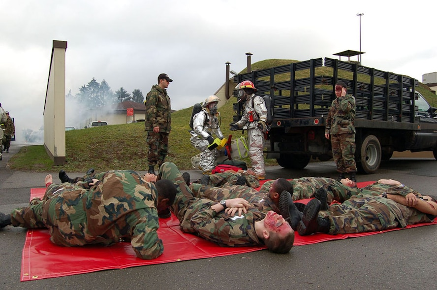 """SPANGDAHLEM AIR BASE, GERMANY -- Volunteer """"victims"""" take part in the wing's Phase I mass casualty emergency management exercise Feb. 9. The exercise was designed to evaluate response elements and command and control procedures during a simulated bus and vehicle head-on collision. (US Air Force photo by Senior Airman Eydie Sakura)"""