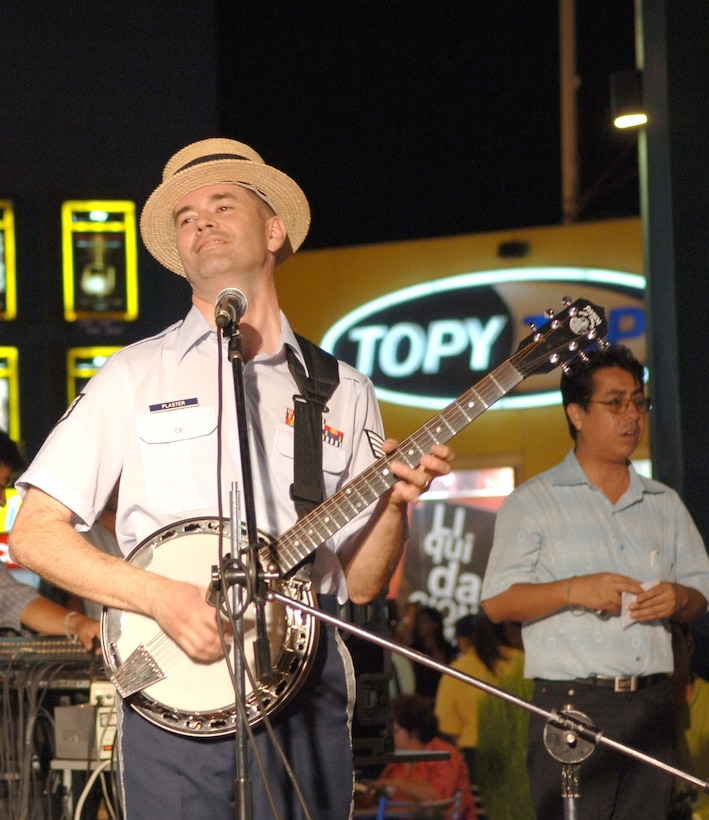 Staff Sgt. Daniel Plaster plays at a mall in Chiclayo, Peru. Sergeant Plaster, along with six other band members from the Air National Guard Band of the Southwest, were in Peru to support the Falcon and Condor 2007, a joint military exercise and air show that provides the U.S. Air Force the opportunity to work together and build relationships with military and civilian leaders of Peru. (U.S. Air Force photo/Tech. Sgt. Kerry Jackson)