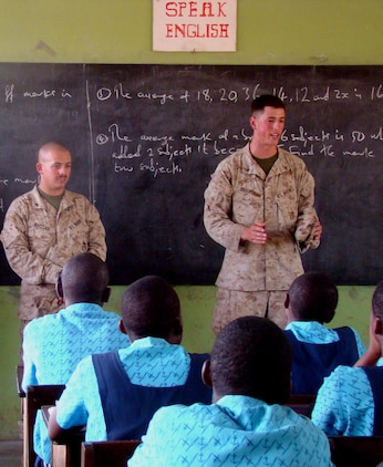 ACCRA, Ghana – Lance Corporals Joshua Brightman and Michael Massad, a team leader and security forces Marine respectively, with the 2nd Fleet Anti-terrorism Security Team Europe, 6th Platoon, share thoughts and experiences with students at the Air Force Base School here Feb. 19. U.S. Marines out of Rota Naval Air Station, Spain, visited the school to answer questions from the students and stress the importance of staying in school. U.S. Armed Forces members are in Accra as part of a joint task force providing infrastructure, aircraft and personnel in support of the President's visits to Benin, Tanzania, Rwanda, Ghana and Liberia Feb. 16 to 21. (U.S. Air Force photo by Tech. Sgt. Denise Johnson)