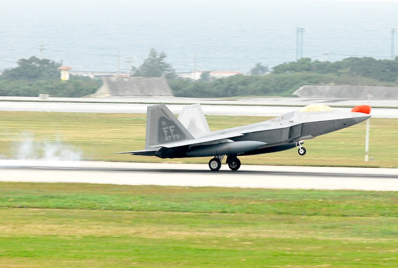 An F-22 Raptor lands at Kadena Air Base, Japan, Feb. 18, marking the aircraft's first overseas deployment. The jet is one of 12 along with more than 250 Airmen deployed from Langley Air Force Base, Va., to Kadena as part of an air expeditionary force rotation. (U.S. Air Force photo/Airman 1st Class Kelly Timney)