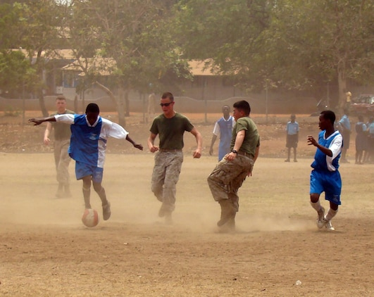 ACCRA, Ghana -- U.S. Marines with the 2nd Fleet Anti-terrorism Security Team Europe, 6th Platoon from Rota Naval Air Station, Spain, accepted a challenge from a soccer team comprised of students from three local schools Feb. 19. U.S. Armed Forces members are in Accra as part of a joint task force providing infrastructure, aircraft and personnel in support of the President's visits to Benin, Tanzania, Rwanda, Ghana and Liberia Feb. 16 to 21. (U.S. Air Force photo by Tech. Sgt. Denise Johnson)