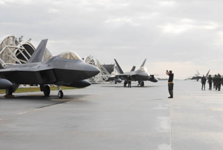 KADENA AIR BASE, Japan -- Crew chiefs park two F-22 Raptors from Langley Air Force Base, Va., after landing at Kadena Air Base, Okinawa, Japan on Sunday, 18 Feb 07. The jets are one of 12 that is currently deployed to Kadena as part of a previously scheduled deployment. It is the first overseas deployment for the Raptor.  (U.S. Air Force photo Airman Sheila deVera)