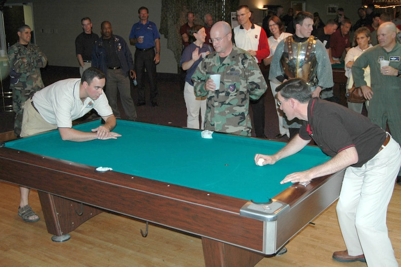 Col. Stephen Tanous, 21st Space Wing vice commander, faces off against 1st Lt. Bill Burich, 341st Space Wing competitor, during the Guardian Challenge CRUD Tournament Aug. 15, 2006, held at the Peterson Air Force Base Enlisted Club. (U.S. Air Force file photo by 1st Lt. Angela Webb)