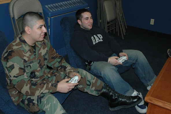EIELSON AIR FORCE BASE, Alaska--Senior Airmen Dominic Garcia and Robert Rosa, both of the 354th Communications Squadron, play a game of Halo 2 after work March 16 at the North Star Cafe in building 2333. Airman Garcia is the Eielson point of contact for Newtroop, an online gaming circuit for servicemembers who play online Xbox, PlayStation and computer games. (U.S. Air Force photo by Airman 1st Class Nora Anton)