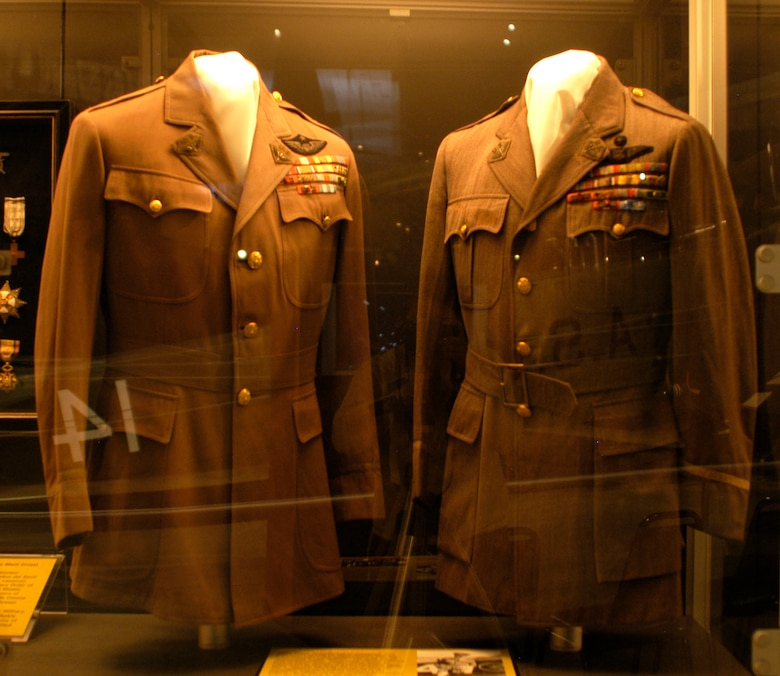 DAYTON, Ohio - Gen. Billy Mitchell's jackets on display in the Early Years Gallery at the National Museum of the U.S. Air Force. The jacket on the right is a non-regulation lapel collar jacket tailored for Gen. Billy Mitchell in July 1923. The jacket on the left is the non-regulation lapel collar jacket tailored for Mitchell in November 1924. This jacket is possibly the one worn by Mitchell during his court martial in December 1925. (U.S. Air Force photo)